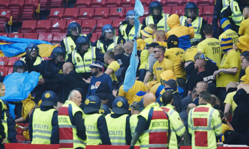Brondby fans scuffle with police during a match
